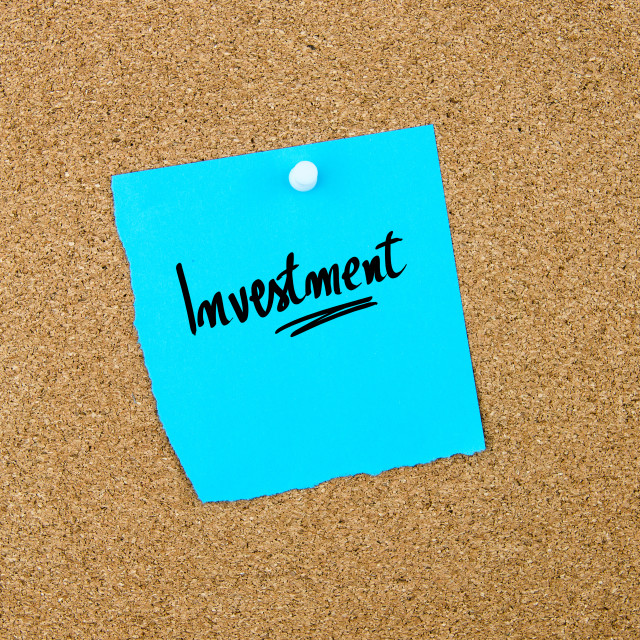 """""""Investment written on blue paper note"""" stock image"""