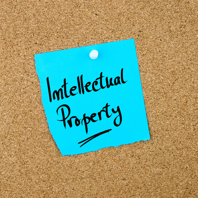 """""""Intellectual Property written on blue paper note"""" stock image"""