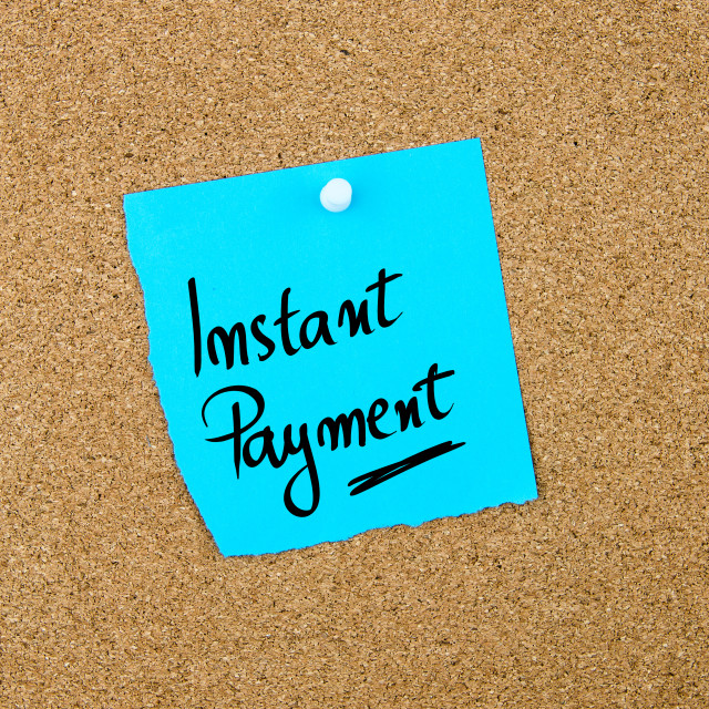 """""""Instant Payment written on blue paper note"""" stock image"""