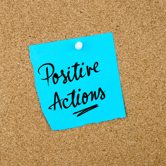 """""""Positive Actions written on blue paper note"""" stock image"""