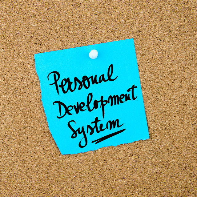 """""""Personal Development System written on blue paper note"""" stock image"""