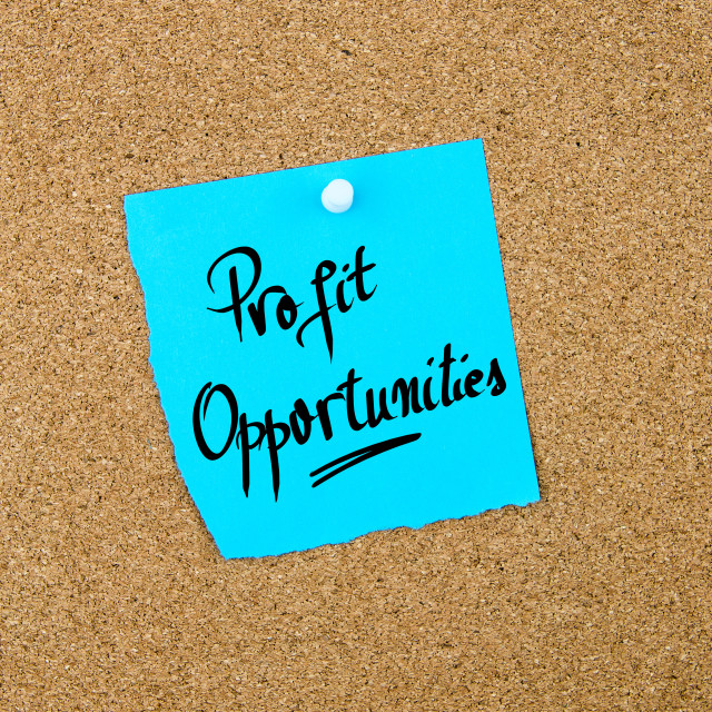 """""""Profit Opportunities written on blue paper note"""" stock image"""