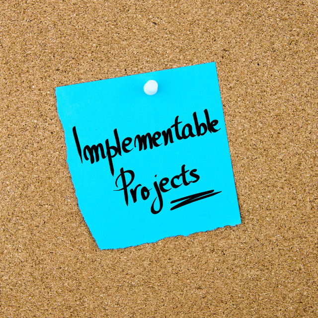 """""""Implementable Projects written on blue paper note"""" stock image"""