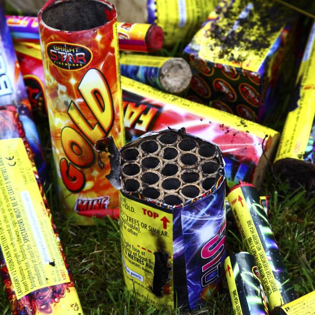 """Heap of used burnt firework shells"" stock image"