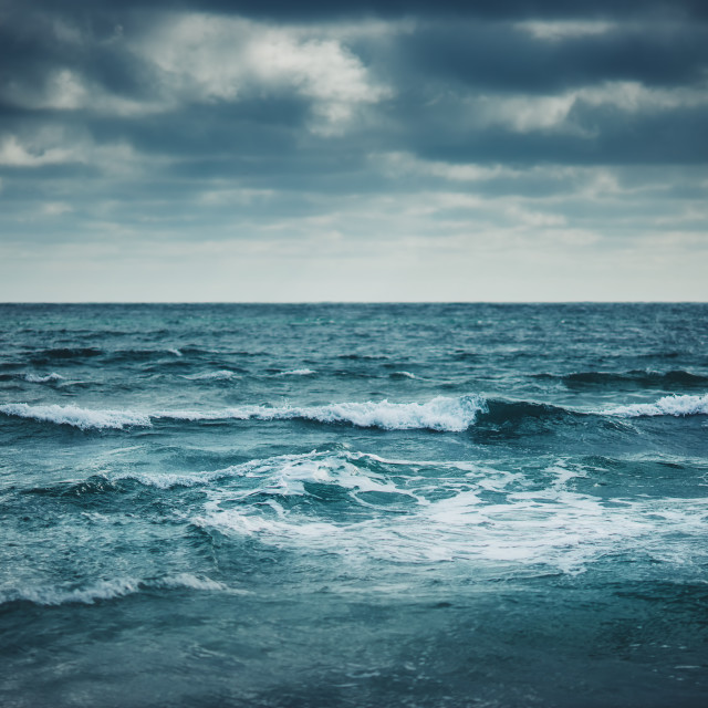 """""""Water waves on cloudy sky background"""" stock image"""