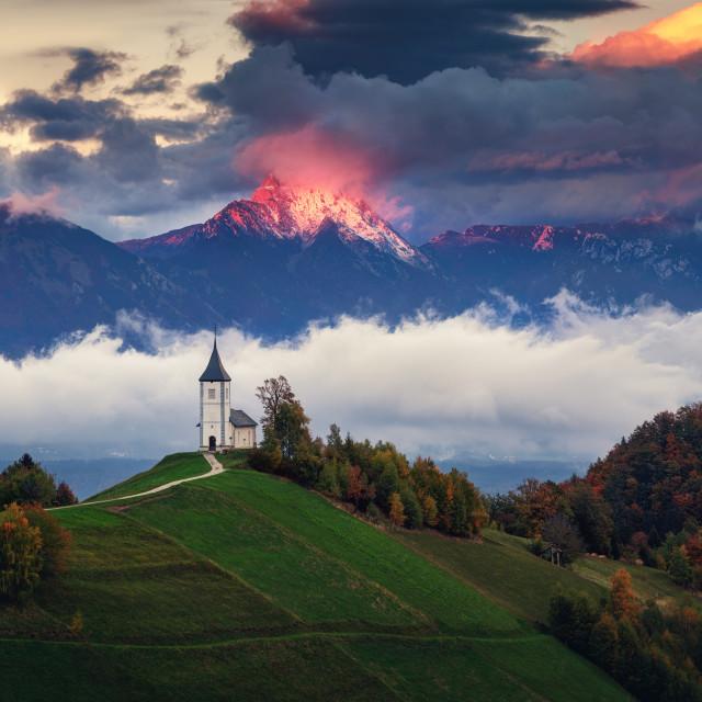 """Jamnik, Slovenia - Panoramic view of rainbow over the church of"" stock image"