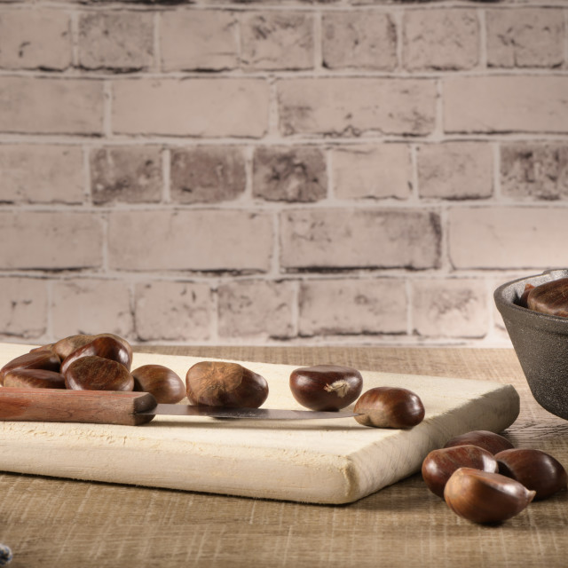"""""""Chestnuts on cutting board"""" stock image"""