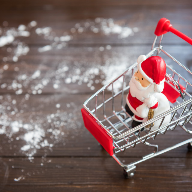 """Santa claus doll on shopping cart"" stock image"