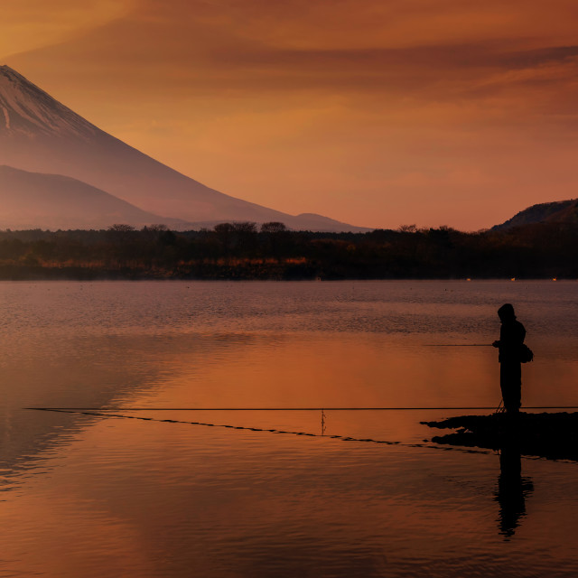 """fishing at Shoji lake at dawn"" stock image"