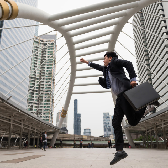 """Asian Businessman hurry in city"" stock image"