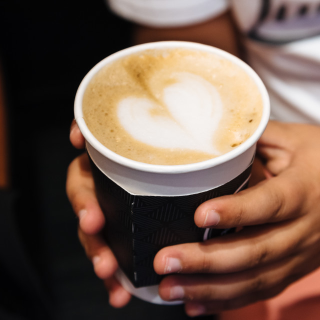 """""""Young male hands holding a cup of coffee drink"""" stock image"""