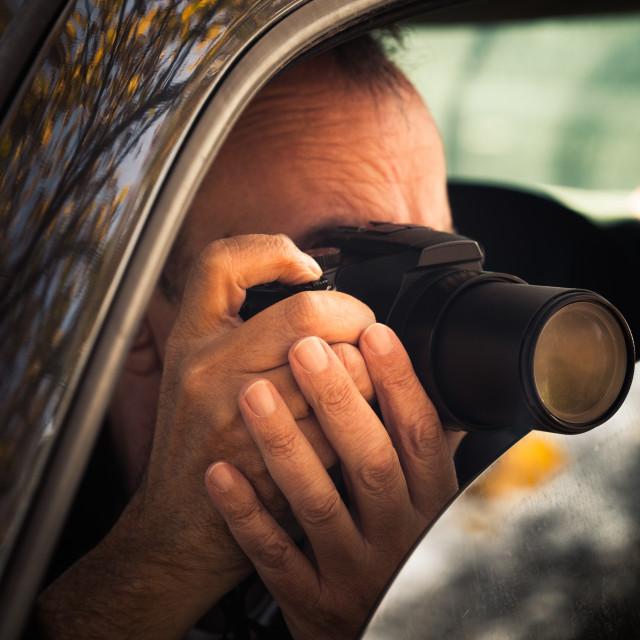 """undercover man hidden in car take photo"" stock image"