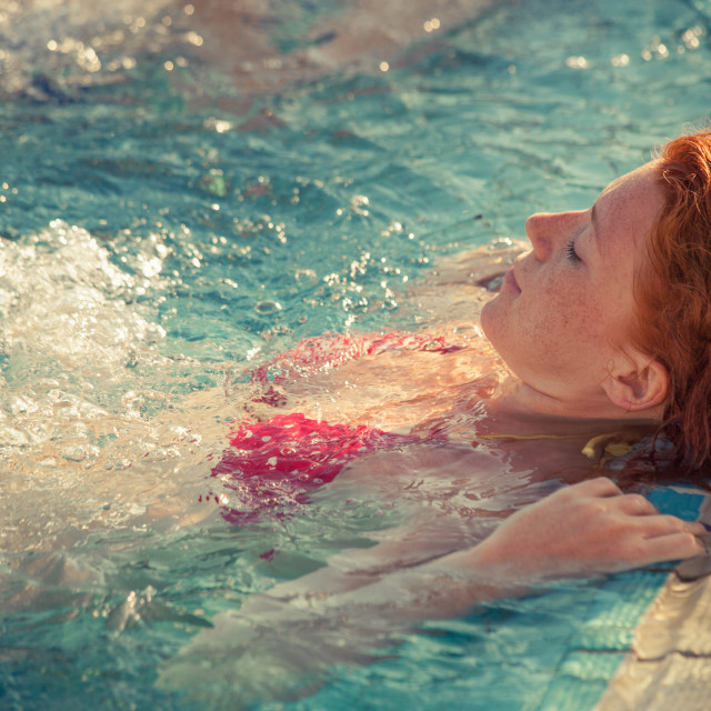 """""""redhead freckled young woman in pool real people concept"""" stock image"""
