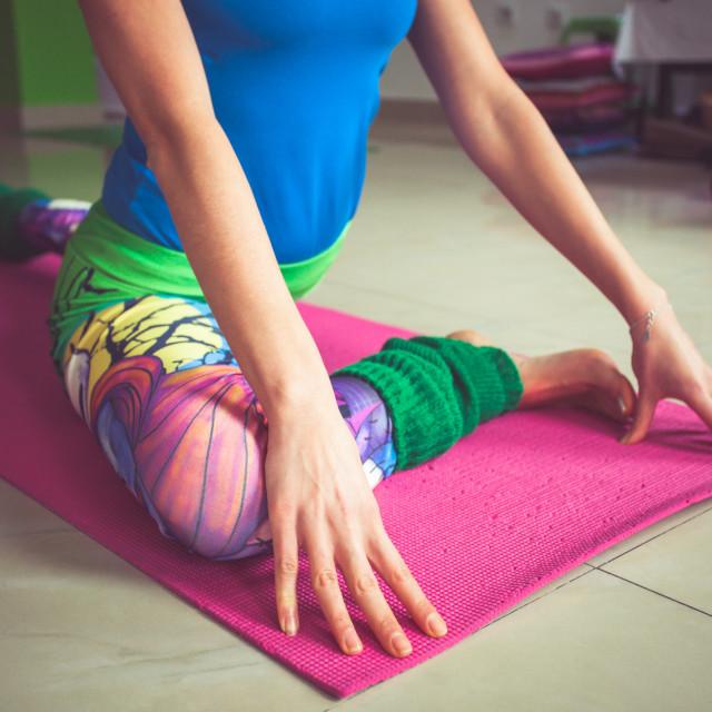 """woman practice yoga indoor extension of lower limbs closeup"" stock image"