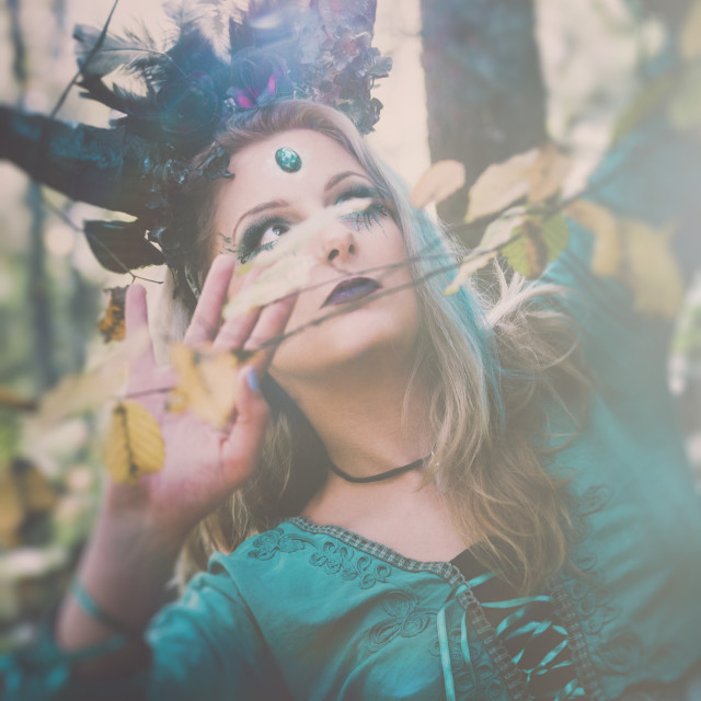 """""""fantasy fairy with horns in forest among trees and branches"""" stock image"""