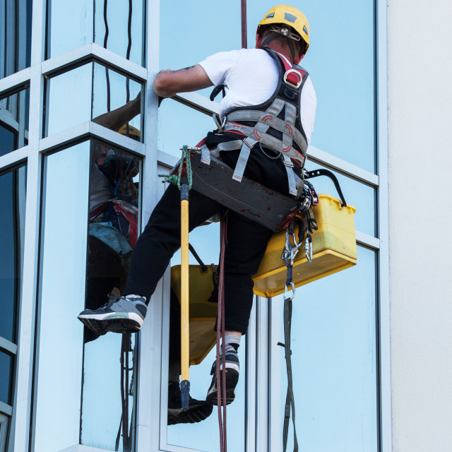 """""""window washer working at building outdoor"""" stock image"""