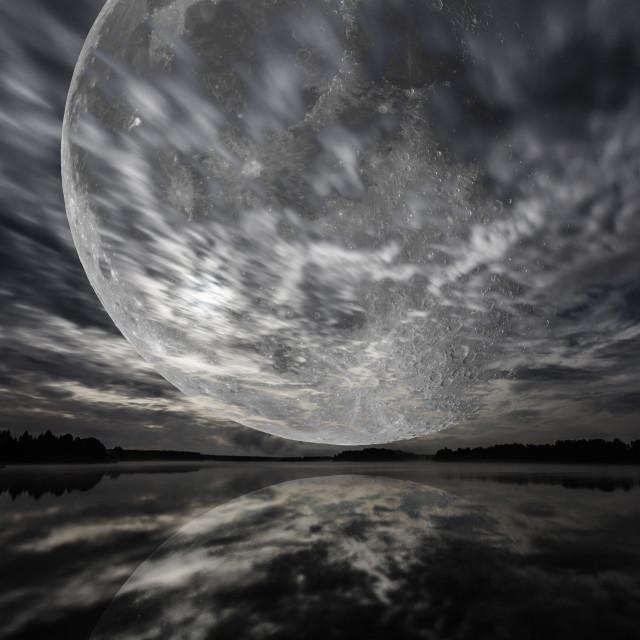"""Mystery landscape, big full moon over dark lake, long exposure shot"" stock image"