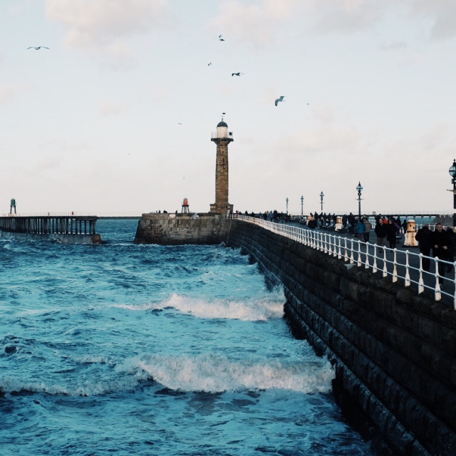 """A bracing walk in Whitby"" stock image"