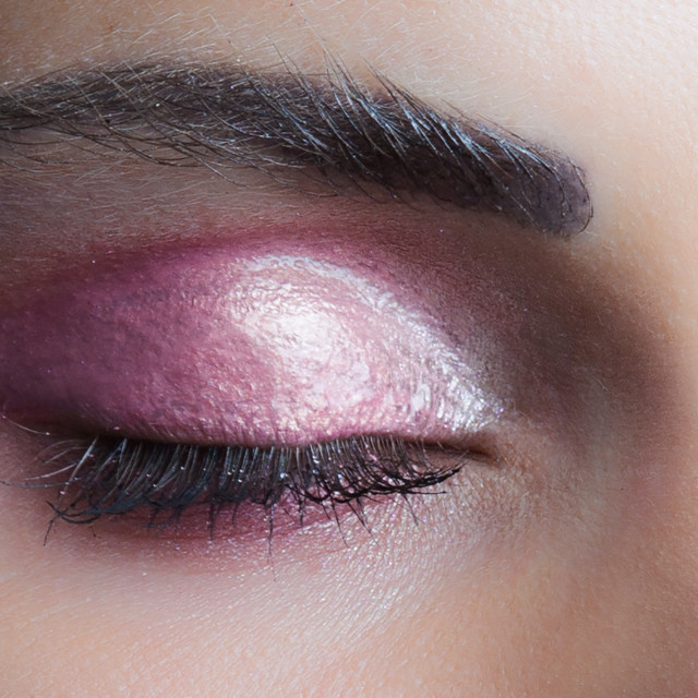 """woman closed eye with perfect pink wet eyeshadow closeup studio"" stock image"