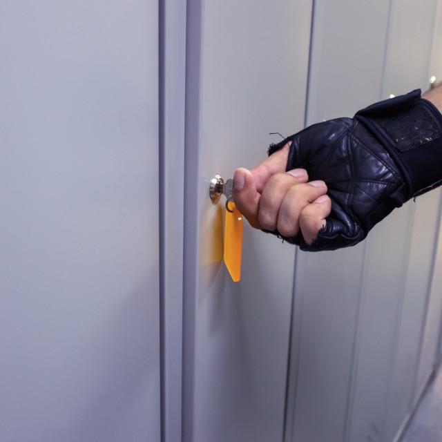 """""""In the men's locker room we open a locker"""" stock image"""