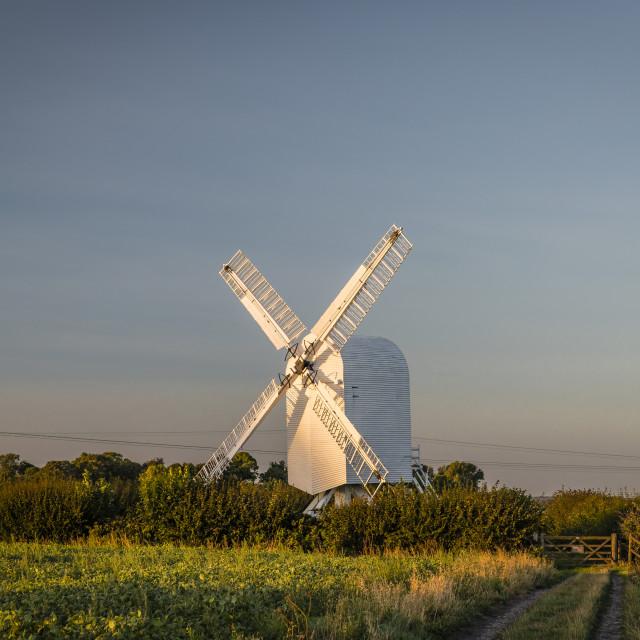 """""""Sun setting on Chillenden Windmill"""" stock image"""