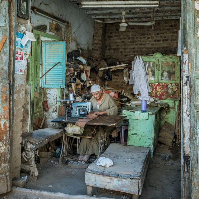 """A poor egyptian tailor sewing in his shed"" stock image"
