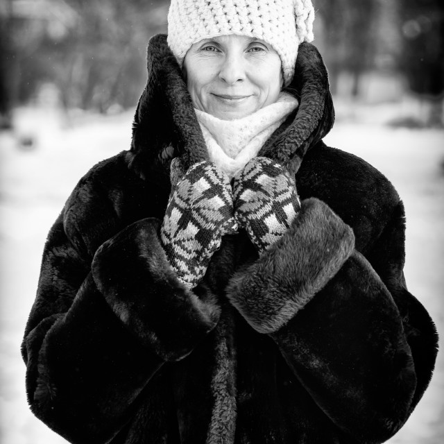 """Winter Portrait of Woman with a Snow Background"" stock image"