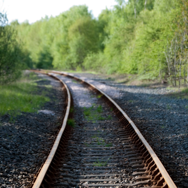 """Train tracks trailing off into the distance"" stock image"