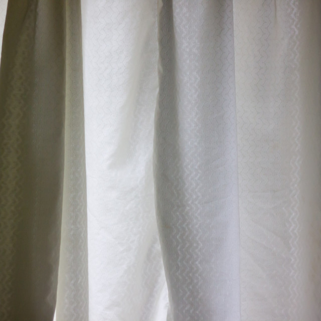 """shadowy textured curtains in the morning light"" stock image"