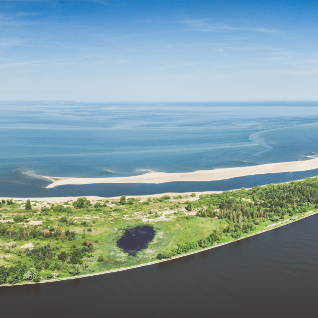 """""""Widefield panoramic aerial view of beach by the blue Baltic sea and Vistula river mouth"""" stock image"""