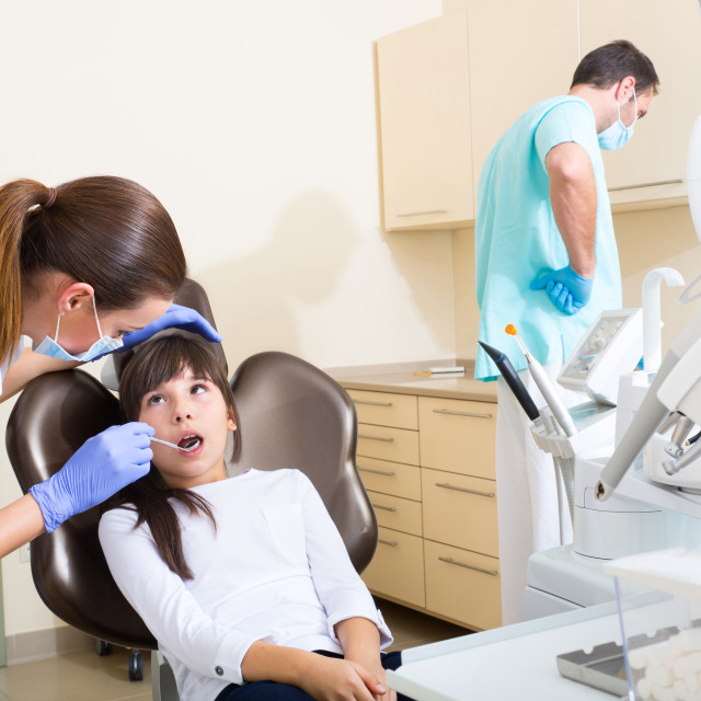 """""""Young girl getting her dental checkup"""" stock image"""