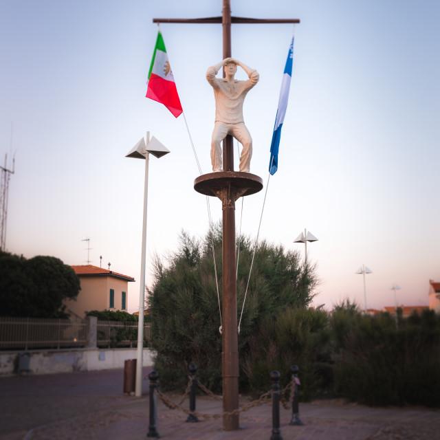 """Sculpture of sailor on wooden mast in Marina Cecina"" stock image"
