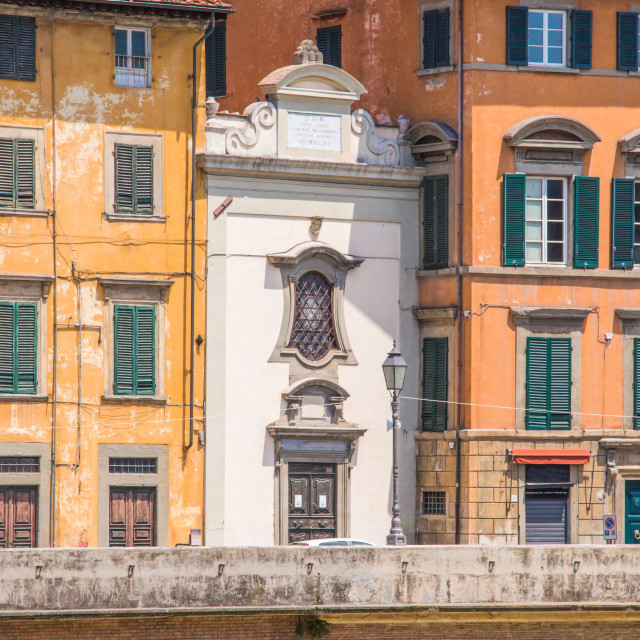 """""""Narrow white house between others in Pisa town"""" stock image"""