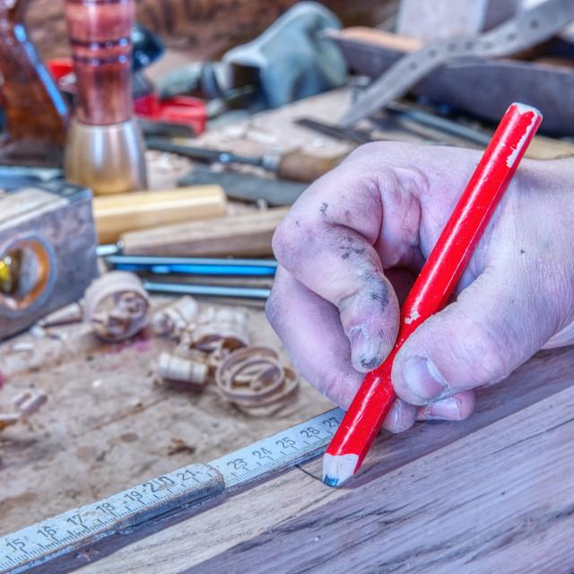 """""""Carpenter working."""" stock image"""