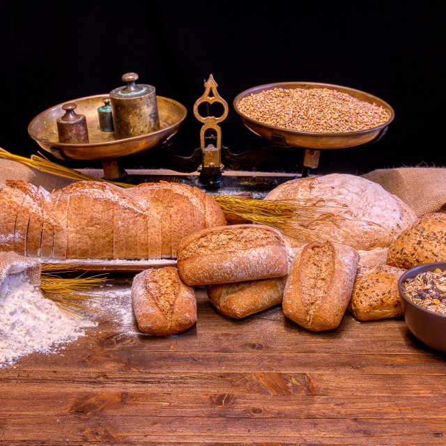 """""""Bread and flour on a rustic wooden table."""" stock image"""