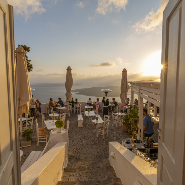 """View of restaurant overlooking Mediterranean Sea, Fira, Firostefani, Santorini"" stock image"