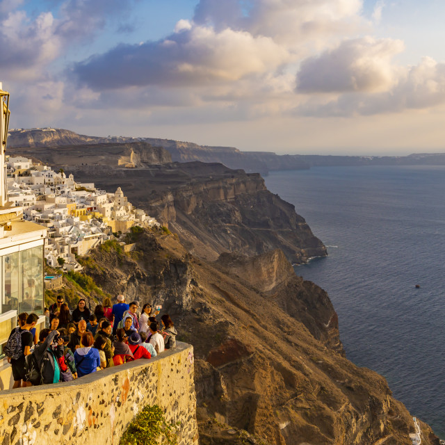 """""""View restaurant overlooking Fira town and Mediterranean at sunset"""" stock image"""