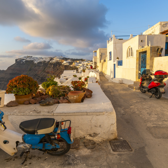 """""""View of Fira white washed houses clinging to rocks, Firostefani, Santorini"""" stock image"""