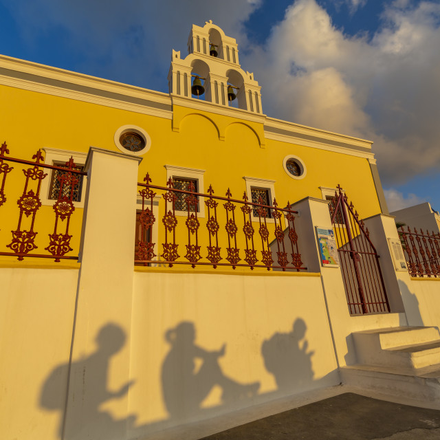 """""""View of shadows of people on wall at sunset, Fira, Firostefani, Santorini"""" stock image"""