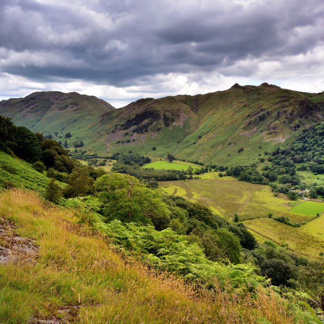 """Dark clouds over the Patterdale common"" stock image"