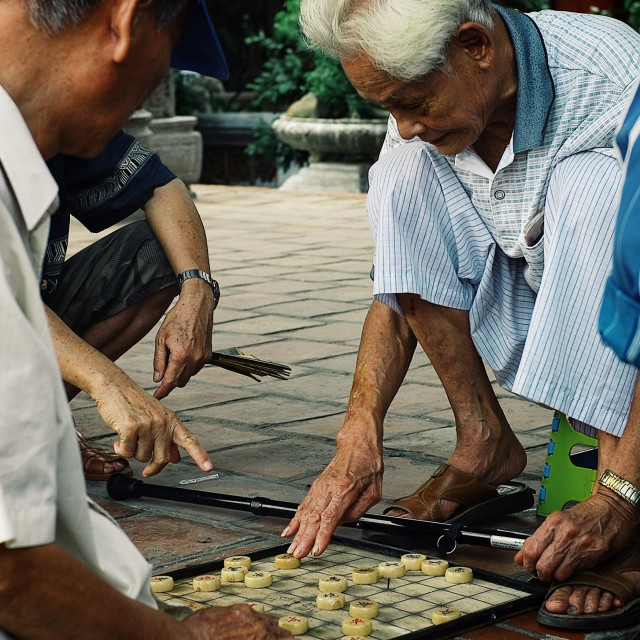 """""""man playing xiangqi the traditional chinese chess game at a square"""" stock image"""
