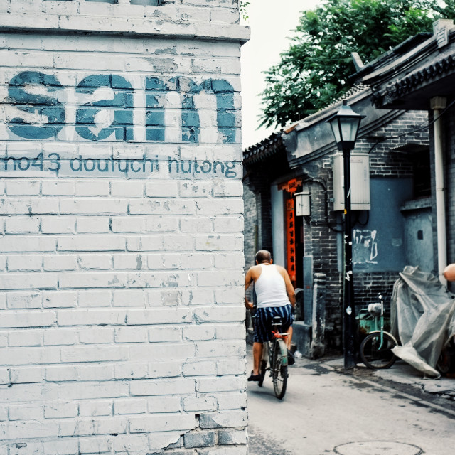"""Beijing / China - JUN 24 2011: residents of the no43 hutong with a big sign on the wall"" stock image"