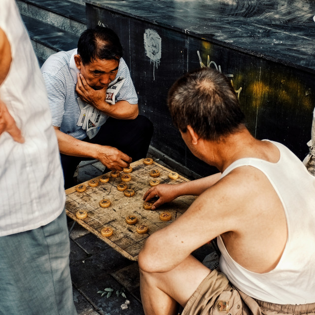 """""""Beijing / China - JUN 24 2011: people playing typical xiangqi chinese chess on the street in a traditional chinese city hutong"""" stock image"""