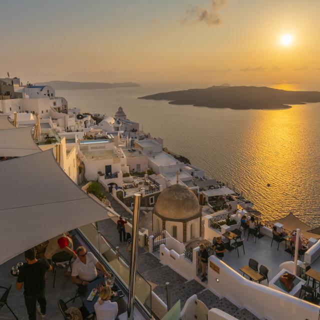 """View of restaurant overlooking Mediteranean Sea at sunset, Fira, Santorini"" stock image"