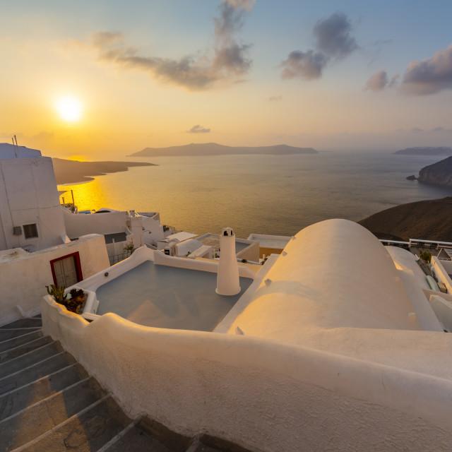 """View of white washed houses and Mediterranean sea at sunset, Firestofani, Santorini"" stock image"
