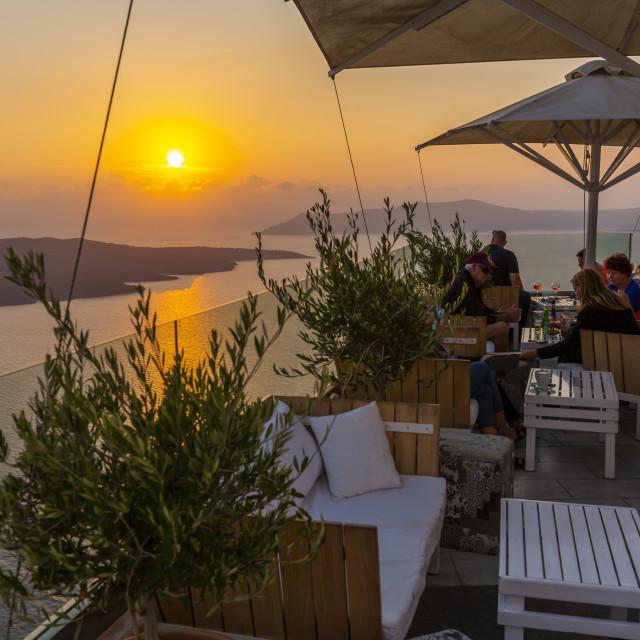 """""""View of Mediterranean sunset from rooftop bar, Fira, Firostefani, Santorini"""" stock image"""