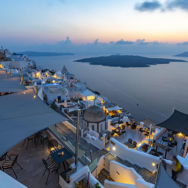 """View of restaurants overlooking Mediteranean Sea at dusk, Fira, Santorini"" stock image"