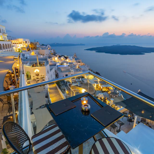 """View of restaurants overlooking Mediteranean Sea at dusk, Fira, Firostefani, Santorini (Thira), Cyclades Islands, Greek Islands, Greece, Europe"" stock image"