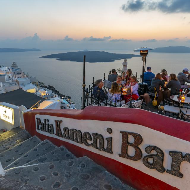 """View of restaurant overlooking Mediteranean Sea at dusk, Fira, Santorini"" stock image"