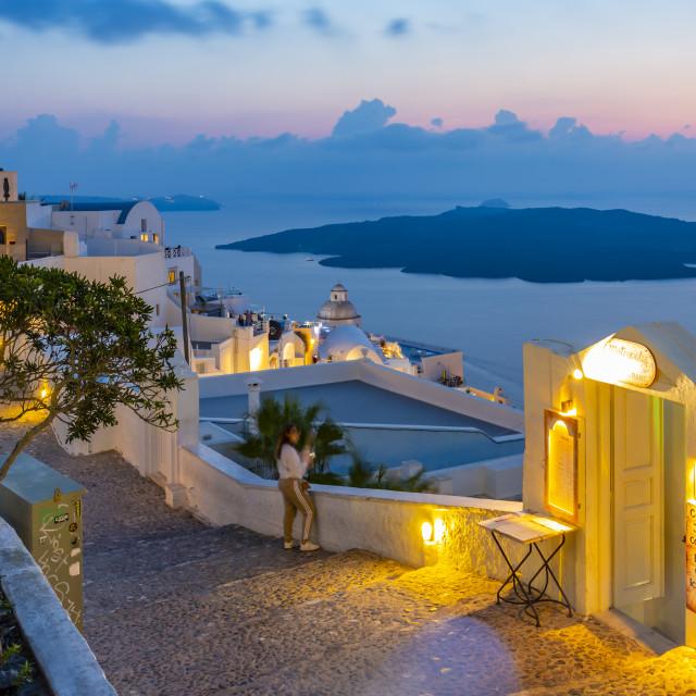 """View of cobbled street overlooking Mediteranean Sea at dusk, Fira, Firostefani, Santorini (Thira), Cyclades Islands, Greek Islands, Greece, Europe"" stock image"